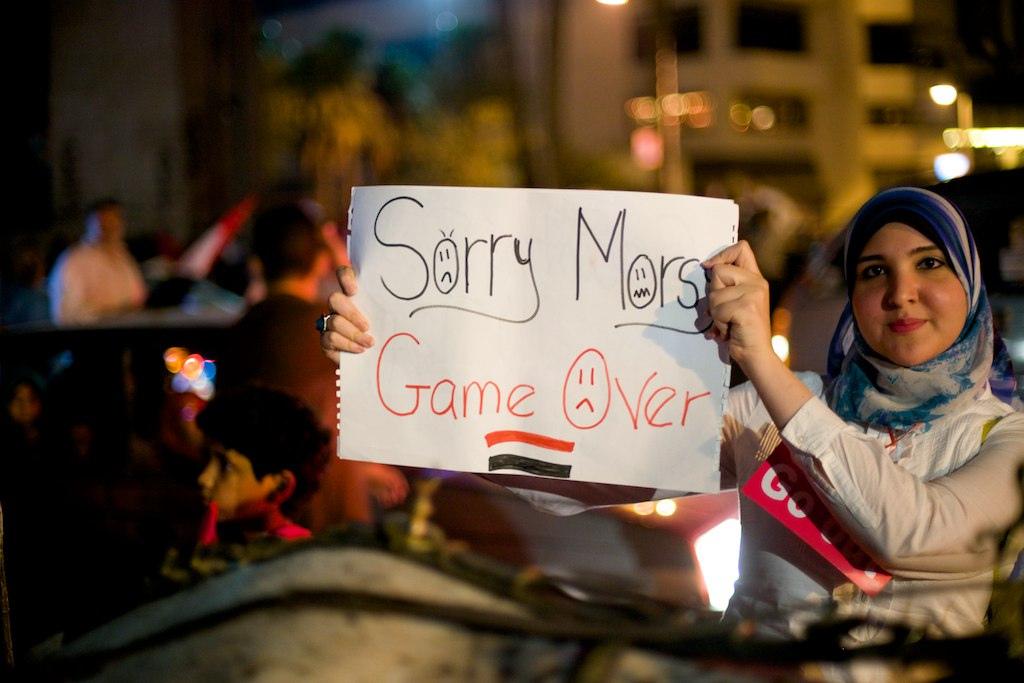 Demonstrant feirer avsettelsen av president Mohamed Morsi 5. juli 2013.