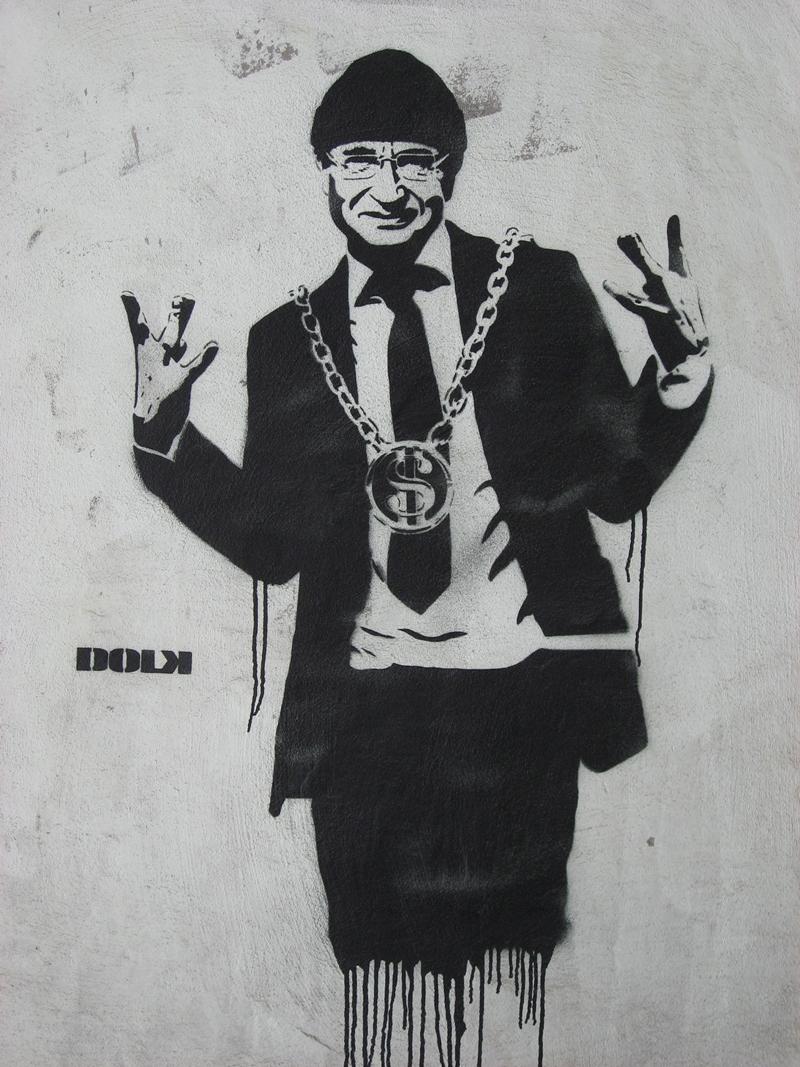 Graffitikunstneren Dolks fremstilling av Bergens daværende ordfører Herman Friele i 2007, på en vegg under Smørsbroen. Graffitien ble senere fjernet av Statens Vegvesen.